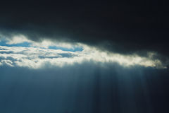 Rays of light through dark clouds Royalty Free Stock Photos