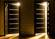 Rays of light from the door in a dark room.  Stock Photo