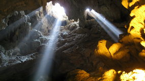 Rays of Light Entering a Cave Stock Photography