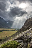 Rays of light. Low clouds on the way to Mushroom rocks, Altai Royalty Free Stock Photo