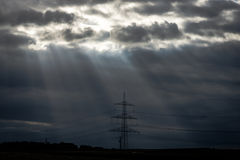 Rays of light making their way through dense clouds Stock Image