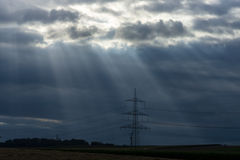 Rays of light making their way through dense clouds Stock Images