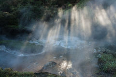 Rays of light over thermal spring in Rotorua Stock Photo