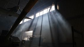 Rays of light pass through the windows of the building.  stock video footage