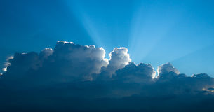 Rays of light shining through clouds. Suitable for background Royalty Free Stock Images