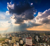 Rays of light shining through dark clouds Royalty Free Stock Image