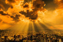 Rays of light shining through dark clouds Royalty Free Stock Photography