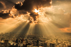 Rays of light shining through dark clouds Stock Photo