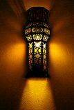 Rays of lights. Wall lights that gives a yellow light and slightly darkshadows royalty free stock image