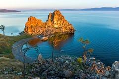 The rays of the rising sun illuminate the rock Shamanka Stock Photography