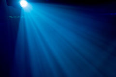 The rays of searchlights in smoke on stage during a performance. Lighting equipment Stock Image