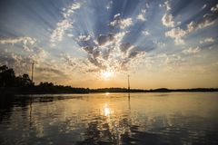 Sunset is reflected on the surface of the lake royalty free stock photo