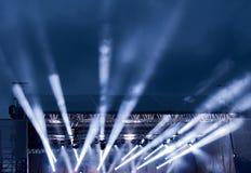 The rays of spotlights against the dark night sky. Stock Image