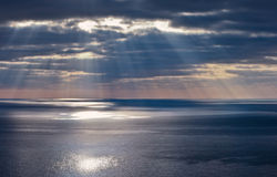 Rays of a sun. Above a sea Royalty Free Stock Photo
