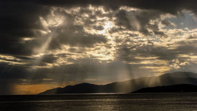 Rays of the Sun. A beautiful display of the sun's rays shining through clouds before a heavy storm at Third Beach in Vancouver Royalty Free Stock Images