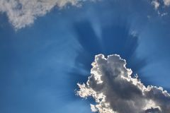 Rays of the sun behind the clouds Stock Photography