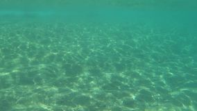 The rays of the sun beneath the sea on a Sunny day.  stock footage