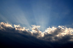 The rays of the sun breaking through the clouds Stock Image
