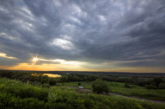 Rays of the sun breaking through the storm clouds. At sunset Royalty Free Stock Images