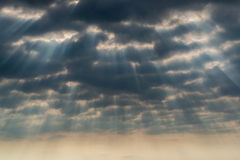 Rays of sun through the clouds Stock Images