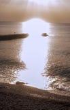 Rays of sun dazzle on sea Royalty Free Stock Image