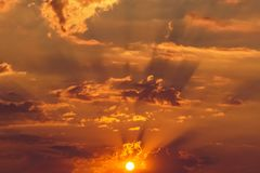 Rays of the sun dramatic clouds gold sunset sunrise. Rays of the sun make their way through dramatic clouds, gold sunset and sunrise Royalty Free Stock Photos