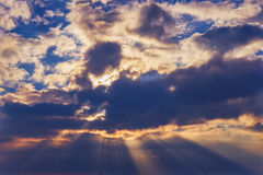 Rays of the sun dramatic clouds. Rays of the sun make their way through dramatic clouds Royalty Free Stock Photos