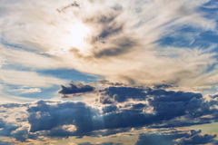 Rays of the sun dramatic clouds Stock Images