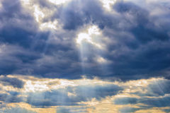 Rays of the sun dramatic clouds Stock Image
