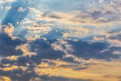 Rays of the sun dramatic clouds. Rays of the sun make their way through dramatic clouds, sunset and sunrise Royalty Free Stock Image