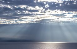 Rays of the sun illuminate the sea and clouds 2. The rays of the sun illuminate the Adriatic Sea. Blue sky with white clouds royalty free stock image