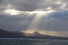 Rays of sun lihgt at the coast Royalty Free Stock Photography