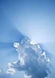 Rays of the sun. Peeking from behind the clouds Stock Images