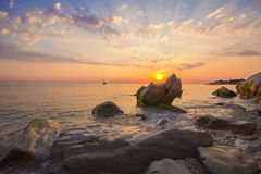 Rays of sun on the sea rocks Royalty Free Stock Photos