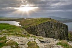 Rays of Sun Shine on Fair Head royalty free stock photography