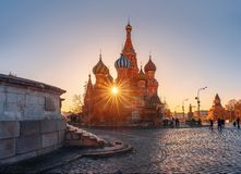 The rays of the sun and St. Basil`s Cathedral. Monument to Minin and Pozharsky under reconstruction royalty free stock photo