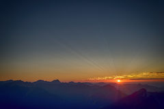 Rays of sun at sunset in tyrol mountains Royalty Free Stock Image