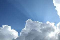 Rays of sunlight over Dutch clouds Stock Photo