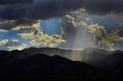 Rays of Sunlight on Peaceful Mountains Stock Photo