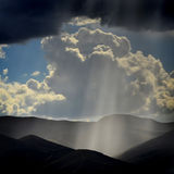 Rays of Sunlight on Peaceful Mountains Stock Photo