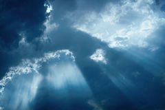 Rays of sunlight shining through cloud cover Stock Image