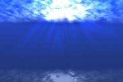 Rays of sunlight shining into sea, underwater view Stock Image