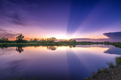 Rays of sunset along river when the sun goes down Stock Photography