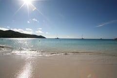 Rays of sunshine. Anse Lazio beach with the sun and rays of sunshine Stock Image