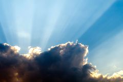 Rays of sunshine breaks through the dark clouds. Concept of hope for , Rebirth,New Beginning royalty free stock images