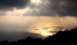 Rays of sunshine through the clouds, pantelleria Stock Image