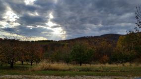 Rays of sunshine. Fall day overlooking a mountain fruit orchard in southwest Va Royalty Free Stock Photo