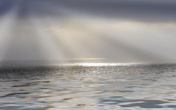 Rays of sunshine over the sea royalty free stock photo