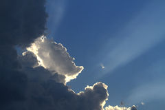 Rays of sunshine. Peaking through storm clouds Stock Photos