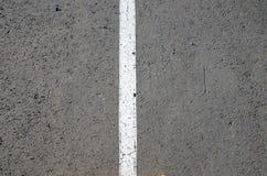 Rayure blanche sur l'asphalte Photo libre de droits